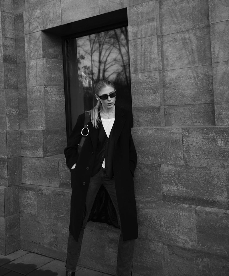 Black and white outfit of the day picture, wearing men's vest and an oversized wool coat